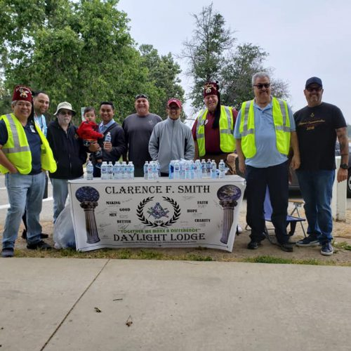 David Karp (third from left) and members of Clarence F. Smith Daylight Lodge No. 866 volunteering at a water station during the Shriners for Children Medical Center's 5k/10k Walk & Run 2 Heal Kids in April.